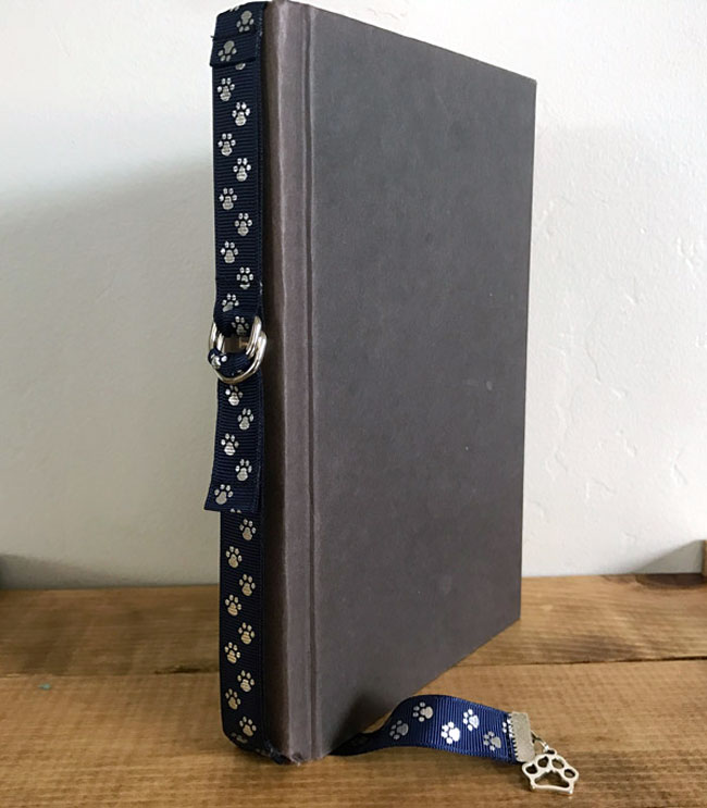 Book Buckle Bookmark is securely attached to a book and ready to use